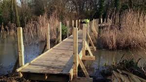 how to build a raised wooden walkway designs