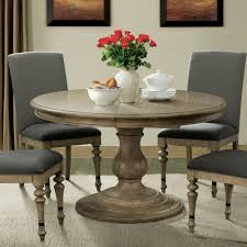 corinne wood round pedestal dining table in sundrenched acacia