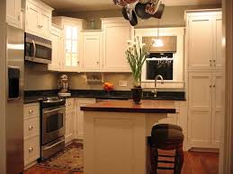 kitchen: White Flowers On Counter Top Closed Two Chair On Wood Floor Inside  Diy Small