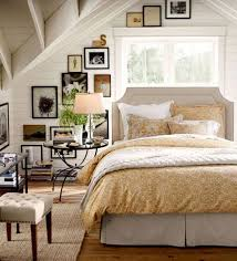 A gallery is the perfect accessory for this bedroom with a sloped ceiling,  from Pottery