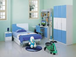 modern kids bedroom for boys featuring soft blue wall paint scheme with single beds plus blue biege study twin kids study room
