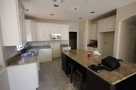 white wash gilbert cabinets with granite countertops