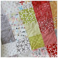 Quilting a Baby Quilt - And Sew We Craft & I love quilting in straight lines ... Adamdwight.com