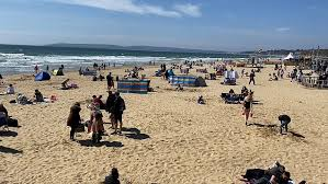 Bournemouth is known for its popularity with pensioners and has many residential care homes because of its constant and warm weather (relative to the rest of england). People Enjoy Sunny Weather On Bournemouth Beach Metro Video