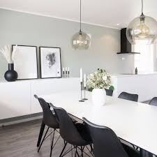 Sophisticated dining room features a lovely wallpaper and crystal chandelier that hung over a dark wood dining table surrounded by gray high back chairs. 18 Gray Dining Room Design Ideas