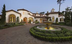 spanish colonial revival architecture exterior mediterranean with brick paving contemporary tiered outdoor fountains