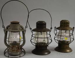 three new york central railroad metal kerosene lanterns with colorless glass globes