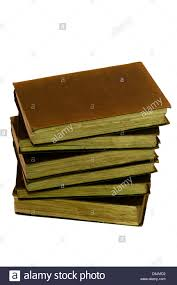 a pile of dusty old books stock image