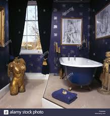 Dark Blue Bathroom Large Gilt Torso Statue In Dark Blue Bathroom With Roll Top Bath