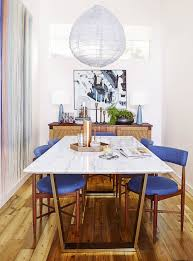 love this long skinny marble dining table surrounded by midcentury modern chairs