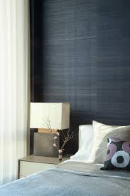 Interior Accent: grasscloth accent wall: Deep indigo sea grass paper from  Hennche Jeffries provides a rich but earthy backdrop for this guest bedroom.