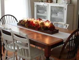 Dining Room. colorful flower bouquet and candle with brown wooden tray on  brown wooden dining