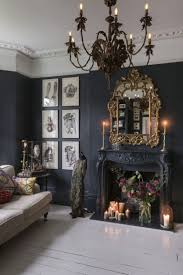 View in gallery Brilliant living room with black, gold and ornate design  [Design: TMS Architects]