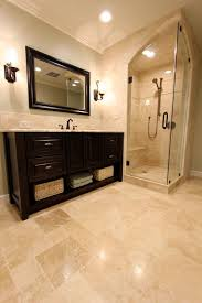 ivory travertine tile bathroom traditional with arch glass door