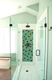 glass tile shower the design below sticks with only on two walls one of which features glass tile shower
