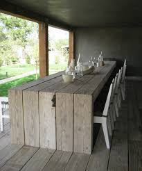 the table is made from a pallet buy the white plastic chairs and