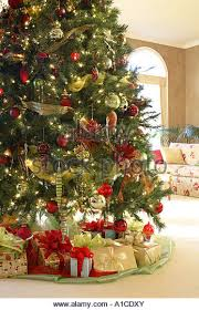 Christmas Tree with Presents under, Decorated Interior - Stock Image