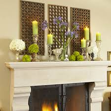 Photo Jean Allsop creatively uses candlesticks with tight bunches of  flowers on this mantle