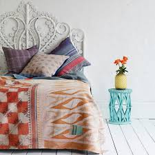 Patterned Bed: The worn finish on the patterned pillows and bed throw dull  its colors, making it easier to pair with other extreme faded patterns.