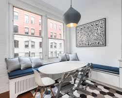 Scandinavian Multicolored Floor Dining Room Idea In New York With White  Walls