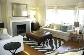putting rug on carpet area rugs over image of interior cleaning with cleaner