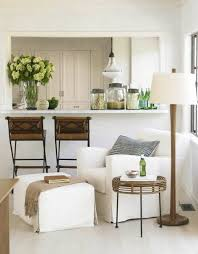 morning room furniture. a holly hunt chair and ottoman are an inviting place to read in the sitting area between kitchen living room morning furniture