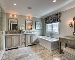 traditional bathroom lighting ideas white free standin. Design Ideas For A Medium Sized Classic Ensuite Bathroom In Orange County With Recessed-panel Traditional Lighting White Free Standin