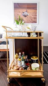 cool bar furniture for lofts. gold bar cart with crystal glasses and striped straws art of man on a beach cool furniture for lofts
