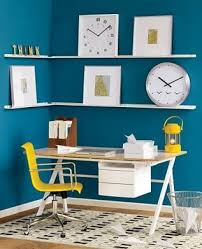 modern office space with blue walls and yellow accents blue office walls