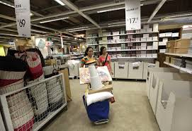 a customer pushes a shopping cart at the 11 furniture store in kunming southwest chinas yunnan province1