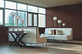 furniture sofa apartment modern couch brick wall interior design indoors luxury mirror lamps contemporary dining room window covering