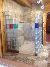 glass block shower with colors in a log home