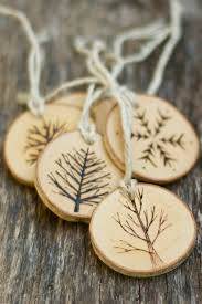 Here's a classy Christmas ornament made of burned wood. It is suitable for  indoor use and will look great in a window or fireplace.