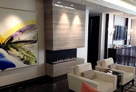 the h series three sided gas fireplace is vent free and features a contemporary trimless