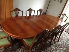 extending yew dining table and 8 chairs eight seater