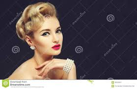 beautiful young with jewels makeup in sixties style