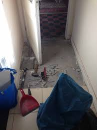 on new years day we set about the rest of the room we used a breaker to get the tiles and cement up and then a crowbar to ease up the lino
