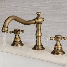 antique brass bathroom faucet. Vintage Antique Brass Three Hole Cross Handle Bathroom Faucet T
