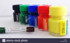 Watercolor Paint Bottles With Brushes On Table