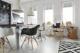 trendy office. Stock Photo - Wooden Modern Desks In White Trendy Office