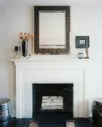 beautiful white washed brick painted white brick with wood piece on the top of