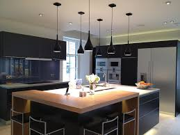 black and stainless kitchen  image of dark kitchen with large square island and stainless steel appliances