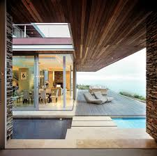 wood flooring ceiling glass sliding doors cliff top home in knyzna south africa