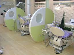 dental office design. divider purple and green contemporary dental office operatories design