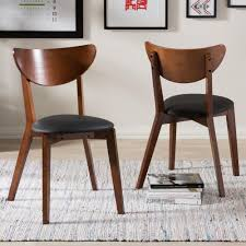 baxton studio sumner black faux leather upholstered dining chairs set of 2