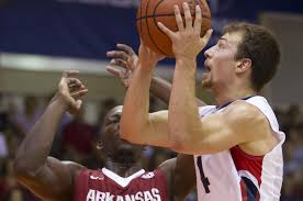 gonzaga s kevin pangos drives on arkansas foward alandise harris at the 2016 maui invitational pangos