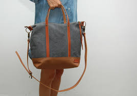 waxed canvas bag with leather handles and closures charcoal color