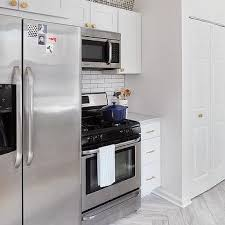 stove and refrigerator. fridge next to stove and refrigerator e