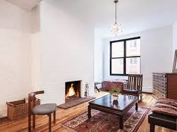 it s not every day that you find a wood burning fireplace but the hearth in this third floor apartment on a tree lined street in s kitchen warms up