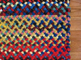 32 x 42 rectangle wool braided rug hand laced in red blue gold in hit miss style made with coat weight wool